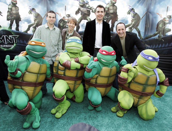 "Voice actors, from top left, Mikey Kelley, James Arnold Taylor, Nolan North and Mitchell Whitfield pose behind their Teenage Mutant Ninja Turtles characters, from left, Michelangelo, Leonardo, Raphael and Donatello, as they arrive at the premiere of the Warner Bros. feature ""TMNT,"" the latest installment of the Teenage Mutant Turtles saga, at Grauman's Chinese Theatre in Los Angeles Saturday, March 17, 2007."