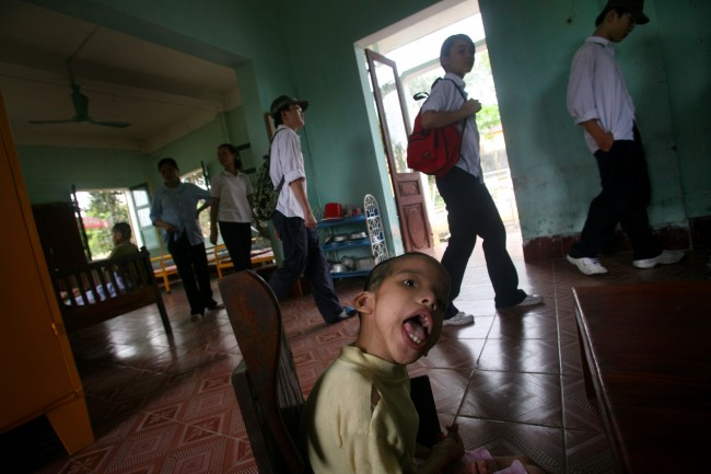 "Vietnamese high school children visit a ""peace village"" center at a hospital in the village of Thuy An, Vietnam which cares for physically and mentally disabled children suspected to have been harmed by exposure to dioxin in the chemical defoliant Agent Orange, in this May 15, 2007, file photo."