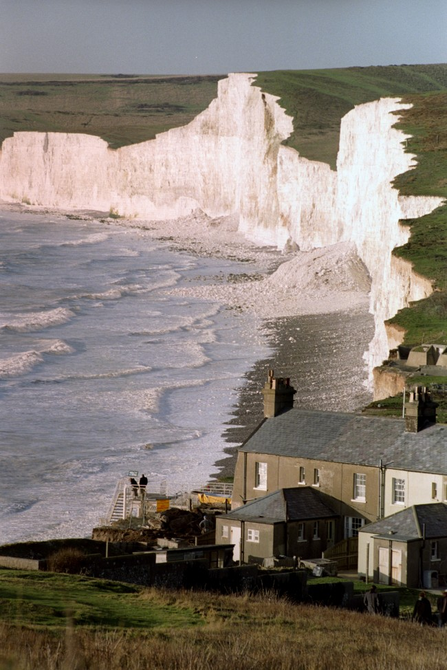 Demolition work on the terraced Coastguard cottage on the cliff at the Birling Gap, Sussex, as the sea erodes the coastline at the beauty spot near Beachy Head. Ref #: PA.839082  Date: 01/01/1995