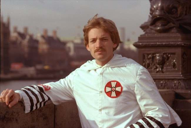 David Duke, 27-year-old Ku Klux Klan leader, poses in his Klan robes in front of the House of Parliament in London in March of 1978. Although he was banned from entering Britain, he arrived here by way of a Skytrain flight from New York.