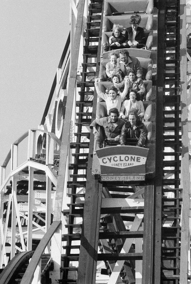 Some lucky New Yorkers get a taste of things to come with warmer weather as they ride roller coaster at Coney Island in the Brooklyn borough of New York, March 25, 1978 during an equipment test. Roller coaster will officially reopen on Saturday, March 24th after being out for maintenance work.