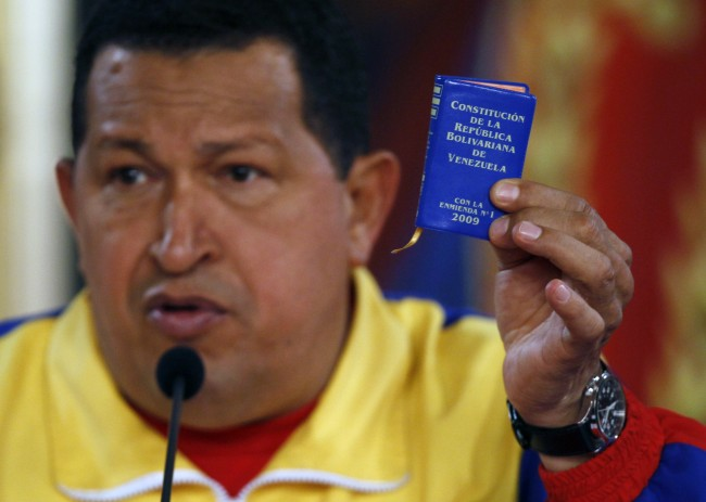 Venezuela's President Hugo Chavez holds up a small copy of the constitution at a press conference with foreign media at Miraflores presidential palace in Caracas, Venezuela, Monday, Sept. 27, 2010. Opponents of Chavez made gains in congressional elections Sunday that weaken the president ahead of his next re-election bid and could force him to deal with rivals. (AP Photo/Fernando Llano)