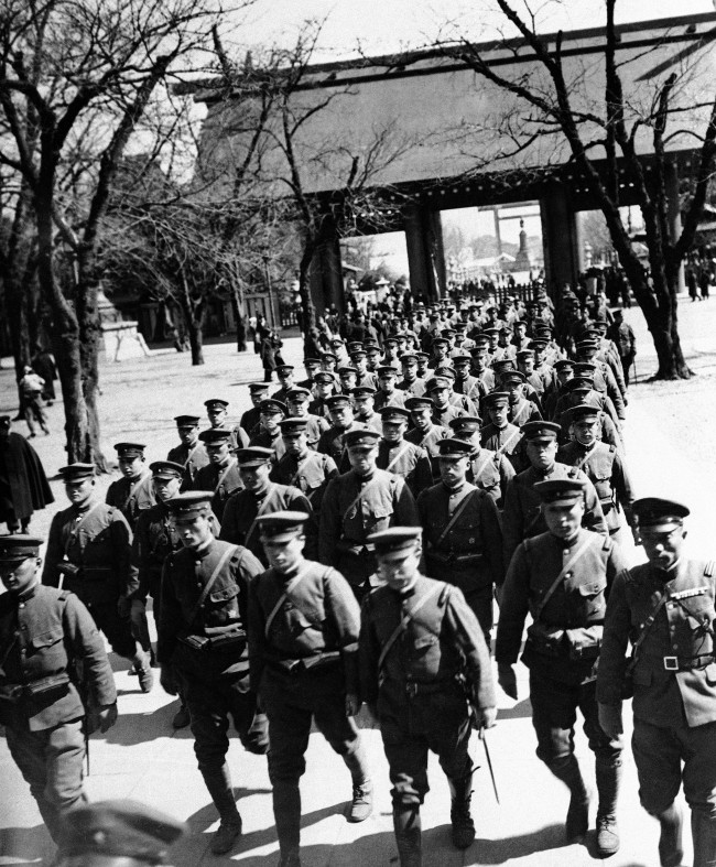 Japanese soldiers of the seventh division, marching from worship at the famous Yasukuni shrine in Tokyo, Japan, March 23, 1935.