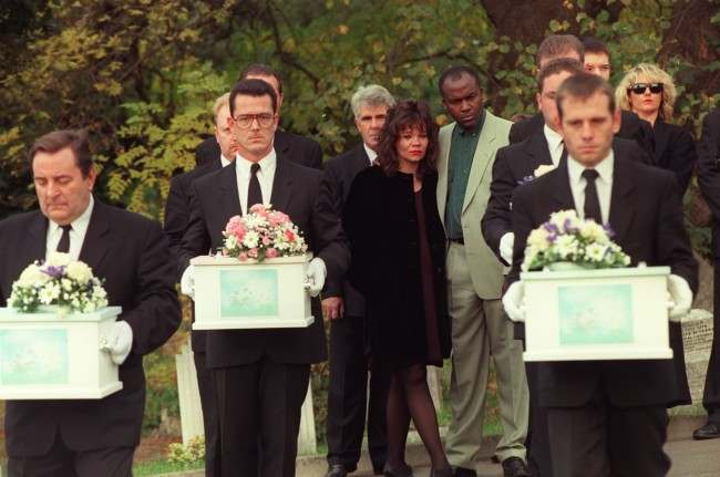 Mandy Allwood with her partner Paul Hudson with the coffins of the eight unborn babies of Mandy Allwood are carried in procession during their funeral in West Norwood Cemetery, London. Max Clifford her publicist stands behind her Ref #: PA.1064797  Date: 14/10/1996