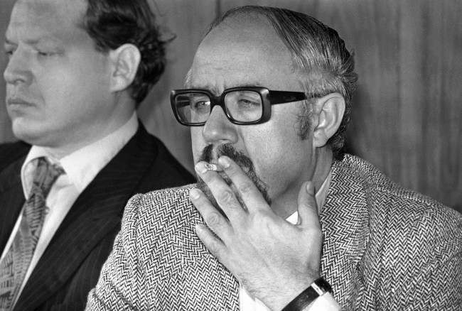 "Former Munich Summer Olympics chief press officer, CSU member of parliament Hans ""Johnny"" Klein, smokes a cigarette on May 2, 1977 in Bonn, Germany."