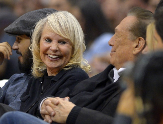 Los Angeles Clippers owner Donald T. Sterling, right, sits with his wife Rochelle during the first half of the Clippers' NBA basketball game against the Houston Rockets, Wednesday, Feb. 13, 2013, in Los Angeles.