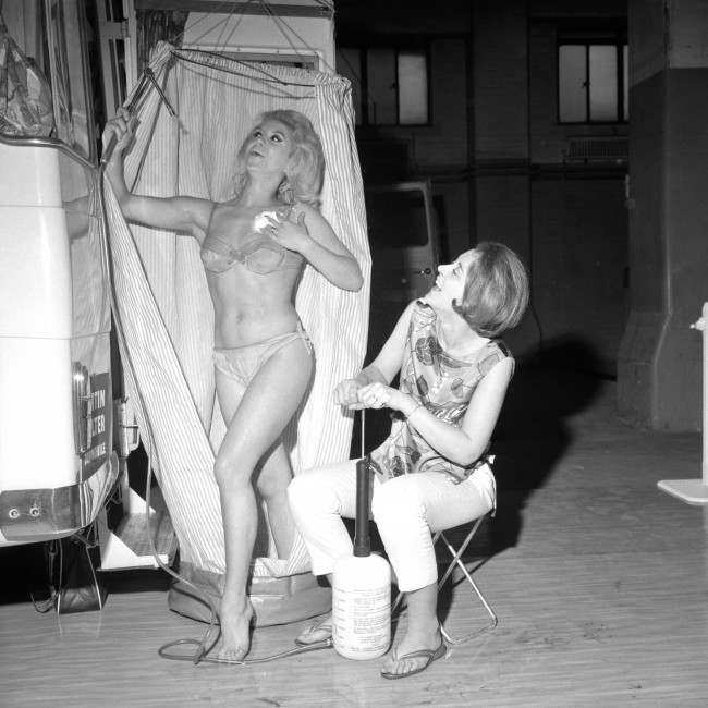 A portable shower, one of the highlights of the show, is demonstrated by (from left) Diane Langton, 22, of Fulham, and Ruth Senior, 25, of Boston, Lincolnshire, on the opening day of the 8th Camping and Outdoor Life Exhibition at Olympia, London. The exhibition is sponsored by the Camping Club of Great Britain and Ireland. Archive-pa126426-1 Ref #: PA.16532050