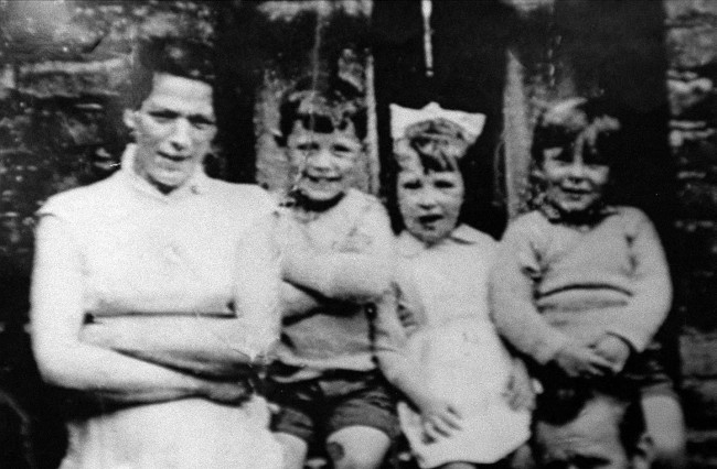 Undated file photo of Jean McConville (left) with three of her children before she vanished in 1972 as Jean McConville's IRA killers tried to silence her son days after she vanished, it has been revealed. Michael McConville, who was 11 when his mother was snatched from her west Belfast home in 1972, was abducted, beaten and threatened at gunpoint by young republicans intent on keeping her disappearance quiet.  Issue date: Sunday November 3, 2013.