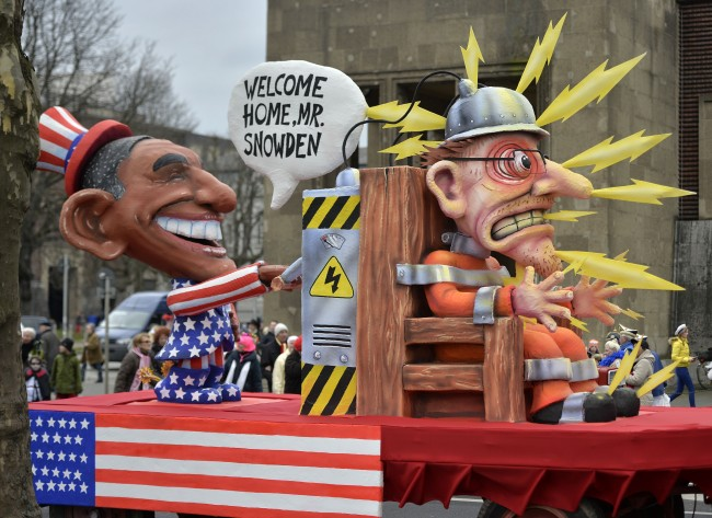 A carnival float depicting US president Obama putting whistleblower Edward Snowden on an electric chair prior the traditional carnival parade in Duesseldorf, western Germany, on Monday, March 3, 2014. The foolish street spectacles in the carnival centers of Duesseldorf, Mainz and Cologne, watched by hundreds of thousands of people, are the highlights in Germany's carnival season on Rosemonday. (AP Photo/Martin Meissner) Ref #: PA.19186971  Date: 03/03/2014