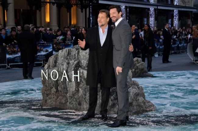 From left, New Zealand actor Russell Crowe and Australian actor Hugh Jackman arrive for the UK Premiere of Noah at a central London cinema, London, Monday, March 31, 2014.
