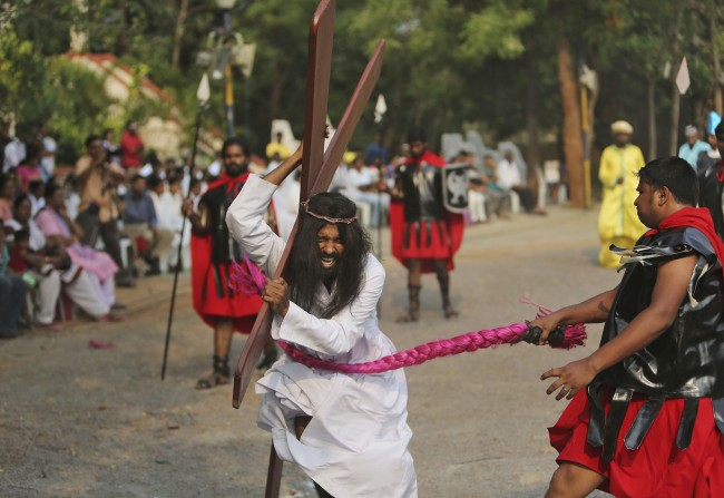 An Indian Christian devotee enacts the crucifixion of Jesus Christ to mark Good Friday at The Mount Carmel Church in Hyderabad, India, Friday, April 18, 2014.