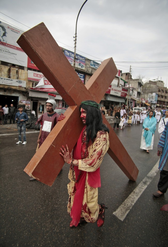 A Christian devotee re-enacts the crucifixion of Jesus Christ to mark Good Friday in Jammu, India, Friday, April 18, 2014.