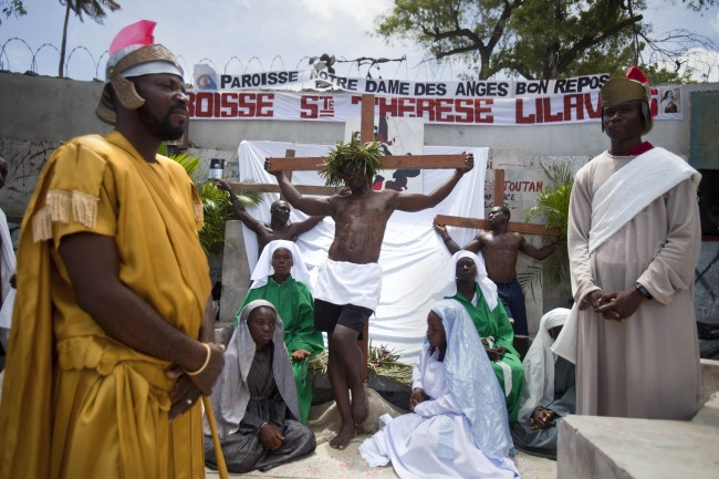 Christians take part in the traditional Good Friday procession, or the 14 Stations of the Cross, reenacting the steps of Jesus Christ's final hours, in Port-au-Prince, Haiti, Friday April 18, 2014.