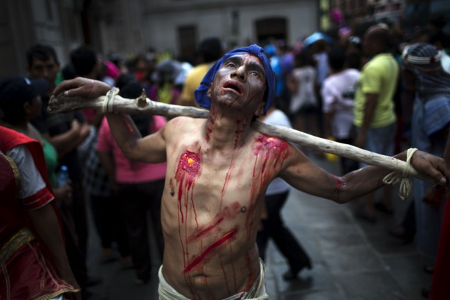 A man performs during the Passion of Christ in Lima, Peru, Friday, April 18, 2014.