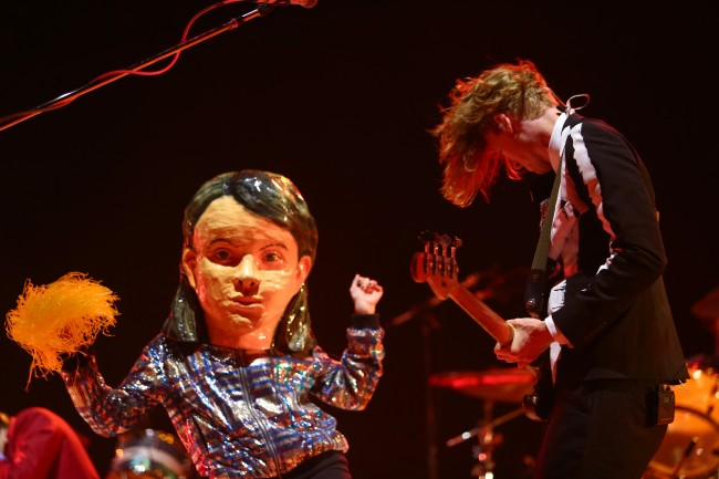 Arcade Fire performs at the 2014 Coachella Music and Arts Festival on Sunday, April 20, 2014, in Indio, Calif.