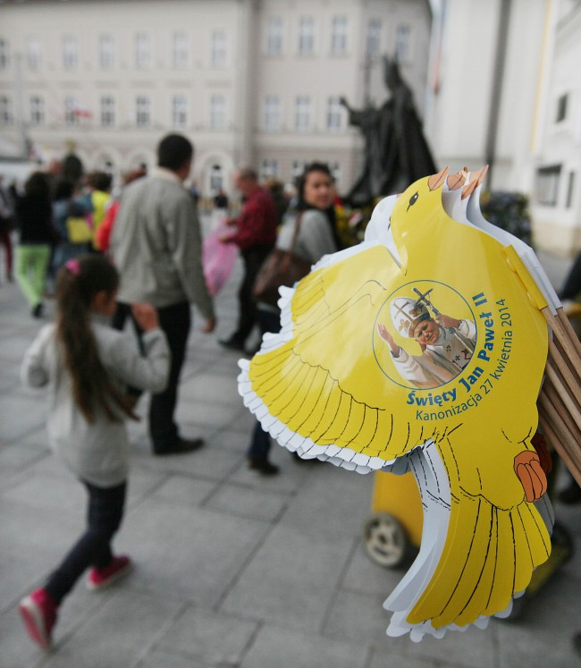 Paper pigeons in papal yellow and white colors and with the image of Pope John Paul II being sold to pilgrims in the pontiff's hometown of Wadowice, Poland