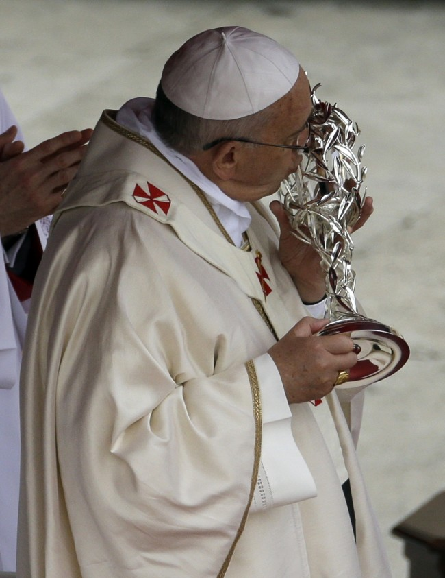 Pope Francis kisses the relic of John Paul II,