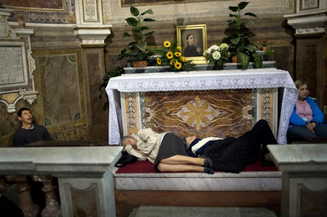 Pilgrims sleep inside a church near St. Peter's Square waiting to attend the ceremony