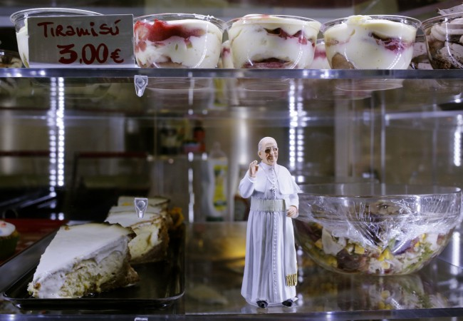statuette of Pope Francis is placed among desserts on sale at a cafe, in St. Peter's Square at the Vatican
