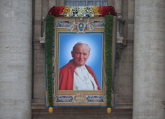 A portrait of Pope John Paul II at St Peter's Basilica in Rome