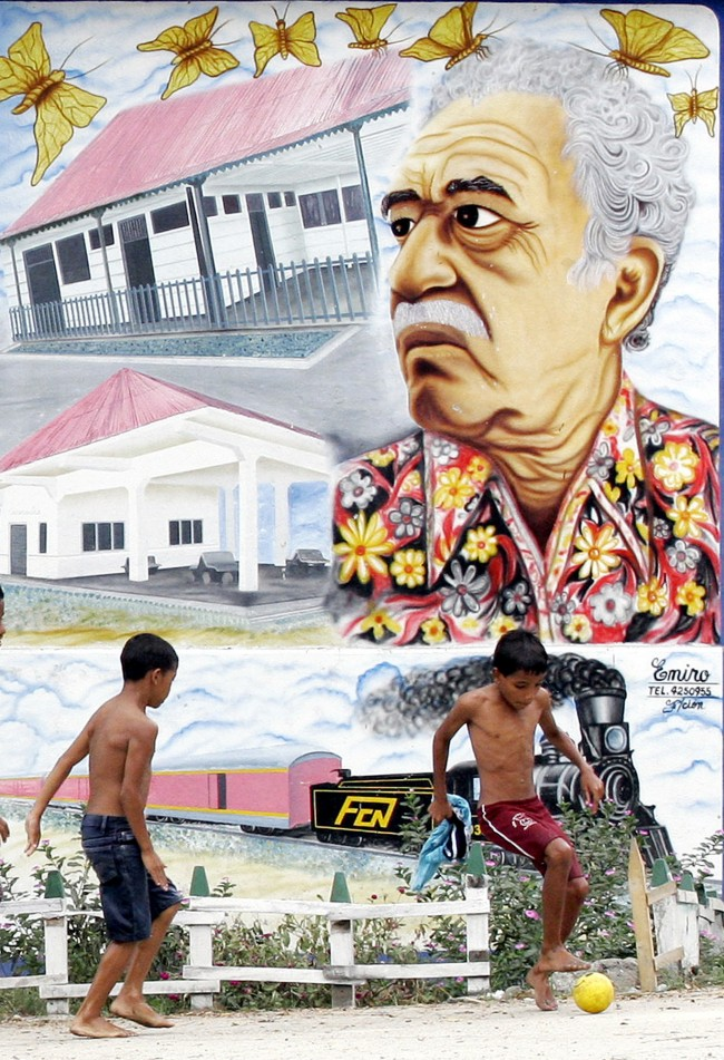 Two boys play soccer in front a mural painting of Nobel Prize-winner Gabriel Garcia Marquez in Aracataca, Colombia, Jan. 4,2006.
