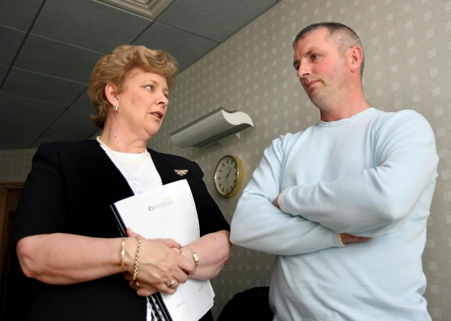 Police Ombudsman Nuala O'Loan with Michael McConville, the son of Jean McConville, at the Ombudsman office in Belfast. Picture date: Friday July 7, 2006. A mother of 10 who was abducted and shot dead by the IRA nearly 34 years ago was officially cleared today of allegations that she was an informer. Northern Ireland Police Ombudsman Nuala O'Loan said her investigators had found no evidence Jean McConville passed information to the security services. See PA story ULSTER Death. See PA story should read:Paul Faith/PA Ref #: PA.3774092  Date: 07/07/2006