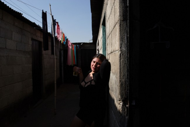 "A prostitute who goes by the name in Spanish ""Gata Salvaje"" or ""Wild Cat,"" waits for clients"