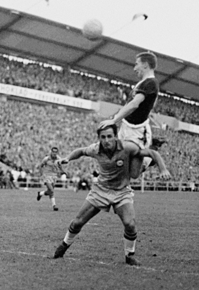 Welsh left winger Cliff Jones leaps and heads the ball over Brazil's right-back Nilton De Sordi towards Brazil's goal during the World Cup Quarter Final match in Gothenburg, Sweden, June 19, 1958. Brazil scored the only goal in the match and meet France in the semi-final