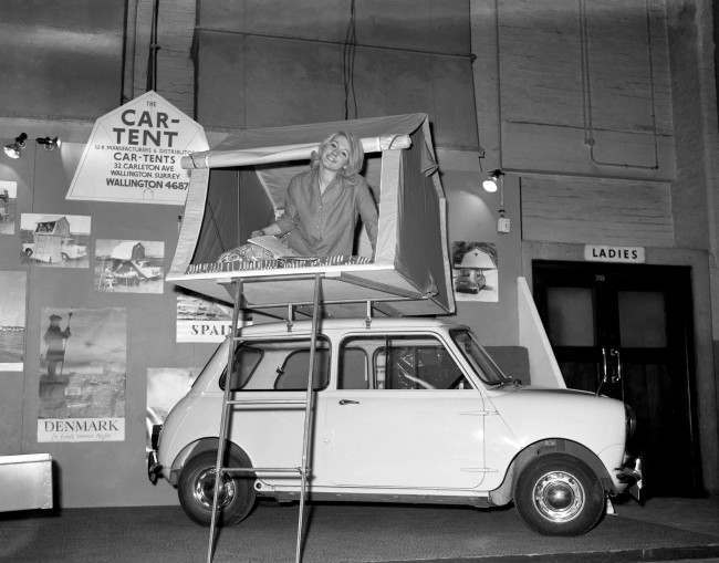 A model demonstrating a car tent. Ref #: PA.6394933  Date: 08/01/1963