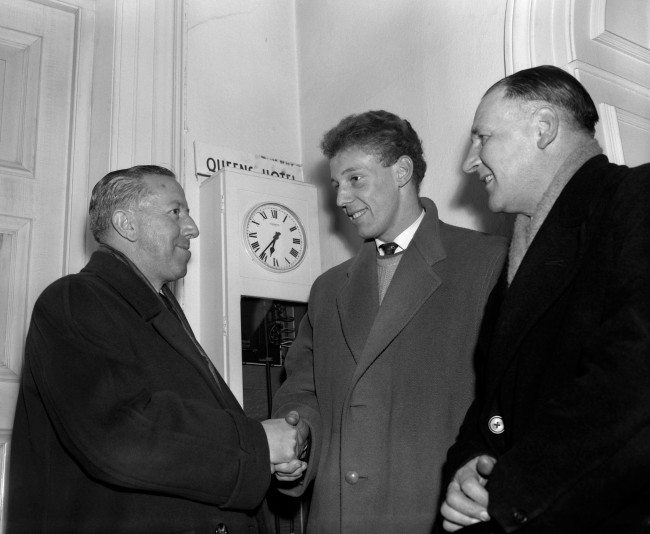 Soccer - FA Cup - Fifth Round - Manchester United v Sheffield Wednesday Manchester United's acting manager Jimmy Murphy (l) shakes hands with new signing Stan Crowther (c) after completing the signing just 55 minutes before kick off - the FA granted Crowther special permission to play in the Cup tie due to the extenuating circumstances of the Munich Air Disaster Date: 19/02/1958