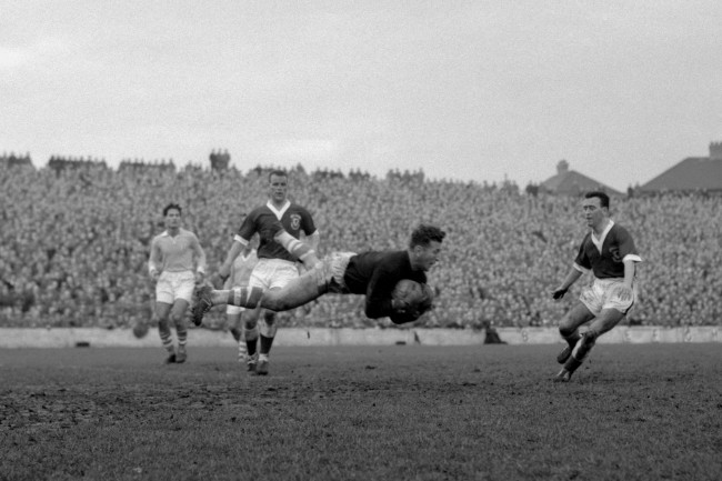 Yaacov Hodorov, Israel's goalkeeper, 'flies' parallel with the turf as he brings off a magnificent save in the World Cup eliminator against Wales at Ninian Park, Cardiff. Immediately behind the keeper is John Charles, released by his Italian club, Juventus, to play in today's match. Wales won 2-0 and go forward to the finals in Stockholm.