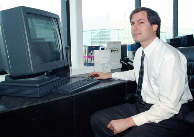 Personal computer pioneer Steve Jobs of NeXT Computer Inc., shows off his NeXTstation color computer to the press at the NeXT facility in Redwood City, Calif., on April 4, 1991. (AP Photo/Ben Margot)