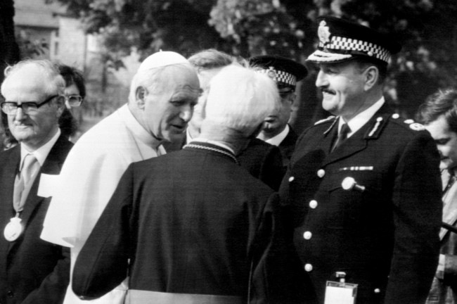 Pope John Paul II is introduced to the Chief Constable of Greater Manchester, James Anderson, at Nazareth House, Manchester Date: 31/05/1982