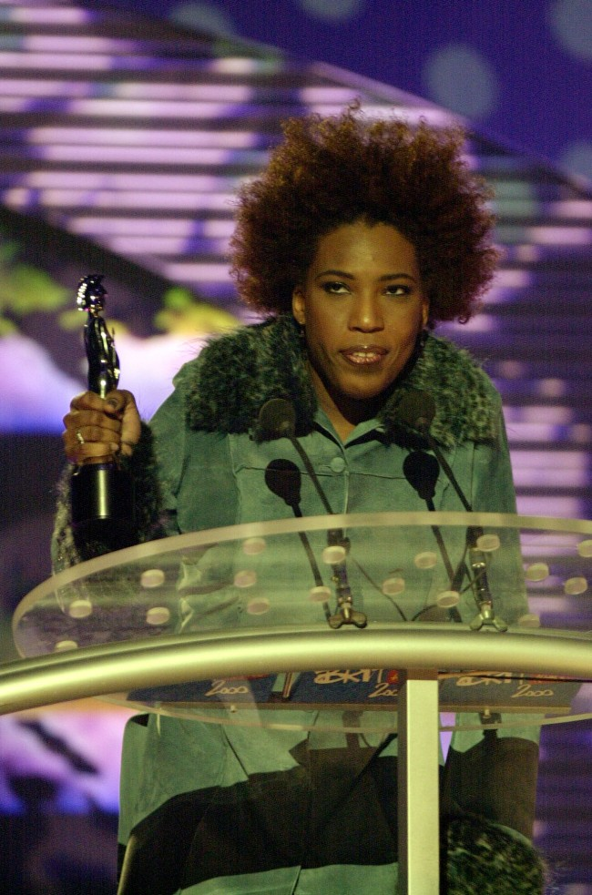 American R&B singer Macy Gray receiving her award for Best International Newcomer, during the Brit Awards 2000 ceremony, held at Earls Court in west London. Date: 03/03/2000