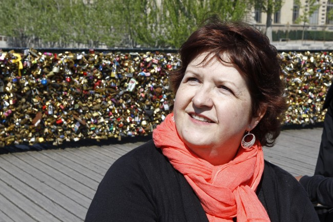 Lisa Taylor Huff from Hackettstown, NJ, speaks with an Associated Press reporter on the Pont des Arts in Paris, Wednesday April 16, 2014.