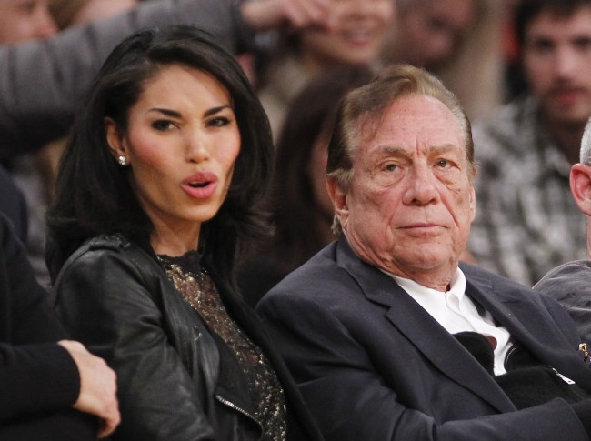 "Los Angeles Clippers owner Donald Sterling, right, and V. Stiviano, left, watch the Clippers play the Los Angeles Lakers during an NBA preseason basketball game in Los Angeles on Monday, Dec. 19, 2010. The NBA is investigating a report of an audio recording in which a man purported to be Sterling makes racist remarks while speaking to Stiviano. NBA spokesman Mike Bass said in a statement Saturday, April 26, 2014, that the league is in the process of authenticating the validity of the recording posted on TMZ's website. Bass called the comments ""disturbing and offensive."" (AP Photo/Danny Moloshok)"
