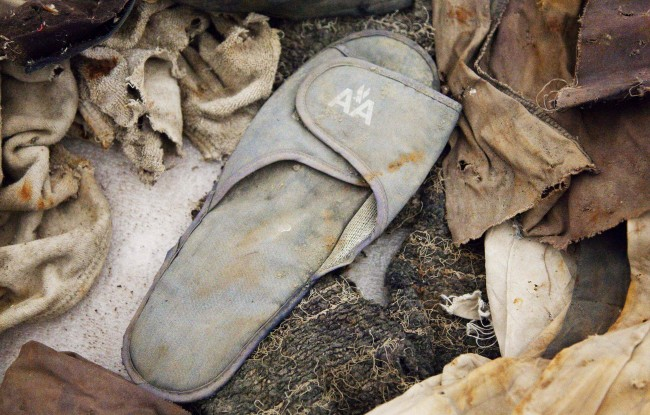 This file photo of June 19, 2011 shows an American Airlines slipper stored in Hangar 17 at John F. Kennedy International Airport in New York. The slipper is an artifact from the Sept. 11, 2001 attacks that is to be part of the National September 11 Memorial Museum