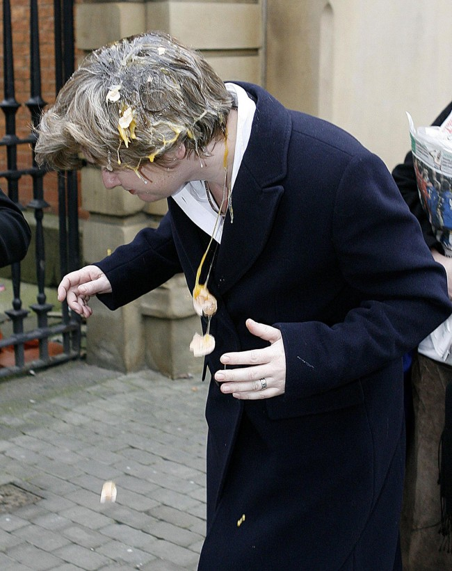 Education Secretary Ruth Kelly recovers after being hit by an egg outside Salford Magistrates Court, Monday February 6, 2006, where Fathers for Justice protester Simon Coverdale is on trial over an alleged incident in which eggs were thrown at the minister while she addressed an audience in Bolton last year.