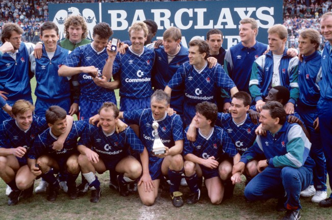 Soccer - Barclays League Division Two - Chelsea v Bradford City - Stamford Bridge Chelsea players celebrate with the Division Two championship trophy after clinching the title with a 3-1 victory: (back row, l-r) Dave Mitchell, Kevin Hitchcock, Dave Beasant, Joey McLoughlin, Kerry Dixon, ?, ? Tony Dorigo, ?, ?, Gordon Durie, John Bumstead, ?; (front row, l-r) Gareth Hall, Kevin Wilson, Peter Nicholas, Graham Roberts, Kevin McAllister, Steve Clarke, Clive Wilson, assistant manager Ian Porterfield (front)