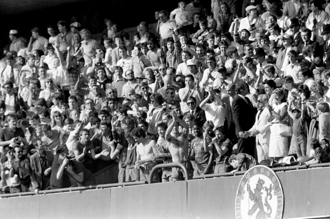Soccer - Football League Division Two - Chelsea v Leeds United - Stamford Bridge (L-R) Chelsea's Joey Jones, Colin Lee, Joey McLaughlin, Kerry Dixon, Paul Canoville and Mickey Thomas salute the fans from the front row of the directors' box after their 5-0 win secured promotion to the first division Date: 28/04/1984