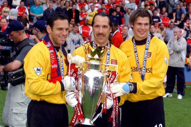 Arsenal's 3 goalkeepers Richard Wright, David Seaman and Stuart Taylor celebrate with the FA Barclaycard Premiership Trophy NULL Ref #: PA.514636  Date: 11/05/2002