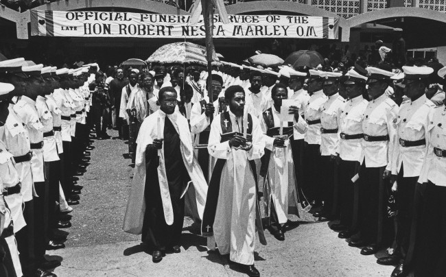 Priests and clergy from the Ethiopian Orthodox Church lead a procession out of the National Arena in Kingston, Jamaica. during the state funeral for reggae musician Bob Marley, May 22, 1981. Marley died of cancer last week in a Miami hospital. (AP Photo/Ray Fairall) Ref #: PA.7509472  Date: 22/05/1981