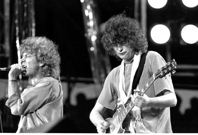 Leadsinger Robert Plant, left, and guitarist Jimmy Page, right, of the British rock band Led Zeppelin perform at the Live Aid concert at Philadelphia's J.F.K. Stadium, on July 13, 1985. (AP Photo/Rusty Kennedy) Date: 13/07/1985