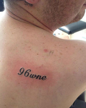 "The ""wne"" tattoo on this football fan's shoulder stands for ""was not enough"""