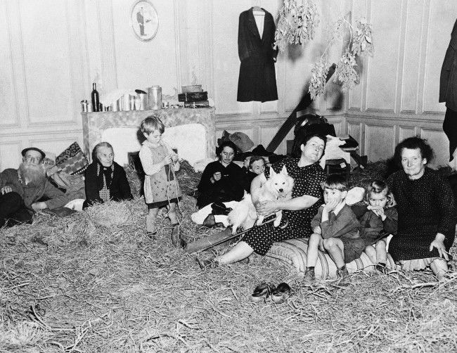 Old and young, these refugees from the French town of St. Lo, in Normandy on July 30, 1944, take up temporary quarters in a former mansion following their return to the newly liberated town. Straw has been placed on the floor to provide a little comfort in the house that are being cared for by Allied Civil affairs authorities. (**Caption information received incomplete) (AP Photo)