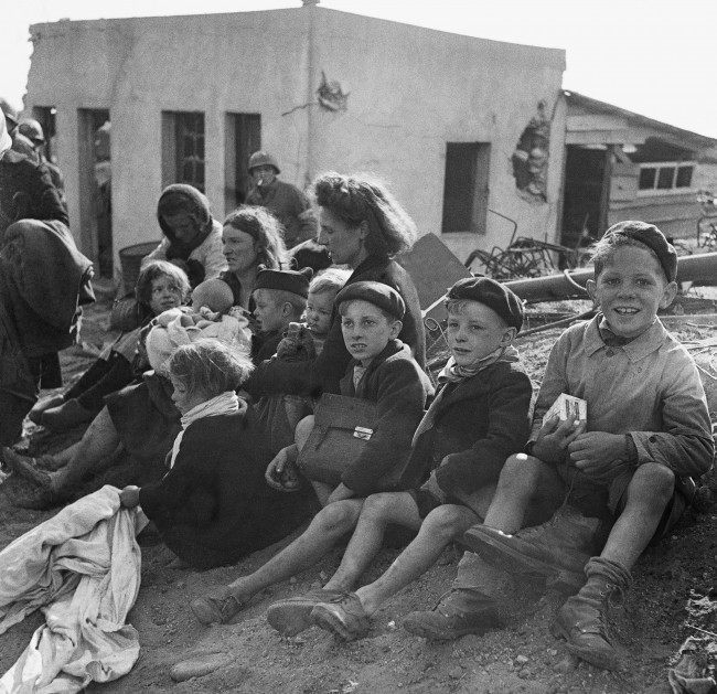 French civilian refugees who sought refuge in a beachhead area in Normandy on June 10, 1944. (AP Photo) Ref #: PA.10847265  Date: 10/06/1944
