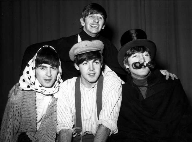 The Beatles pictured in costume for a sketch during dress rehearsal at the Finsbury Park Astoria, London, of 'The Beatles Christmas Show'.  Date: 24/12/1963