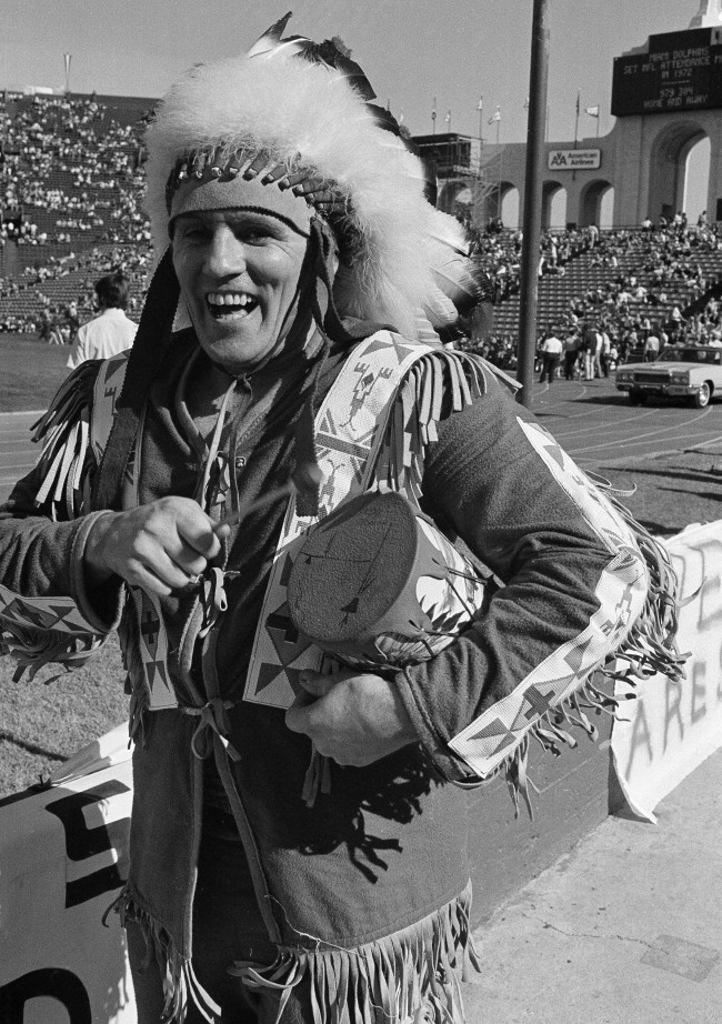 Andy Blanch, wears a Native American costume and plays his drum to show support for the Redskins during Miami vs Los Angeles Super Bowl game in Los Angeles, Jan. 14, 1973. (AP Photo)