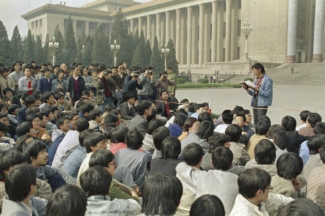 In this April 18, 1989 file photo, a Chinese student leader reads a list of demands to students staging a sit-in in front of Beijing's Great Hall of the People. A quarter century after the Communist Party's attack on demonstrations centered on Tiananmen Square on June 4, 1989, the ruling party prohibits public discussion and 1989 is banned from textbooks and Chinese websites. (AP Photo/Kathy Wilhelm, File)
