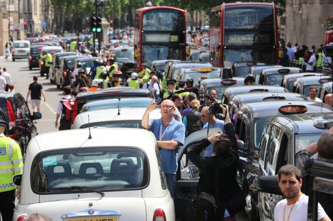 Black cab and licensed taxi drivers protest at Trafalgar Square, London over the introduction of a phone app called Uber which allows customers to book and track vehicles.